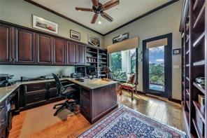This impressive office has a private patio entrance so when you need a break, just step outside and inhale some peace and tranquility! More custom cabinetry and mill work add to the beauty and functionality of the space.