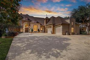 This gorgeous stucco & stone home boasts manicured gardens, huge driveway with tons of parking, 7 car climate controlled garage for classic car collection or workshop space and over 7,000 square feet of luxurious & stylish living. Coveted MISD!