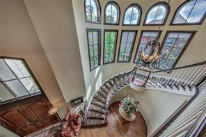 Let s climb this winding staircase to the second floor. This home also features a back staircase to make this floorplan functional and convenient for everyone! Motorized chandelier lowers for easy maintenance.