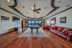 Huge recreation/game room perfect for billiards, cards or just watching TV. Wired with speakers for surround sound, more wood molding and ceiling detail enhance the space. Check out that view!