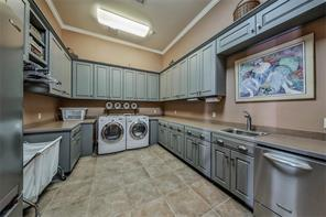 Ground floor Utility room features sink, storage and everything you need to keep your house running smoothly all day long!