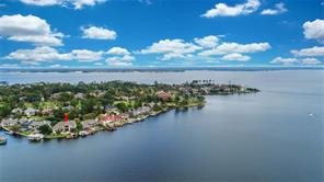 Perfectly situation on this large, prime lot in a very wide open cove gives you the best of both worlds. Wide open water views from the protection of a cove, enjoy water for miles while preserving your bulkhead & extending life of your watercraft.