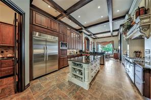 More dramatic beam detail accents elegant slate flooring double ovens, convection microwave, luxury gas range, island seating & storage, walk in pantry plus service pantry. Truly too many upgrades to list!
