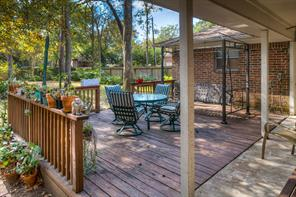 Large deck to enjoy the gorgeous mature trees