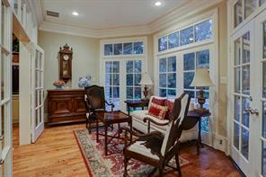 At the rear of the home lies a charming and lovely sun room. It adjoins the family room with large cased openings and French doors.