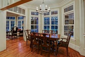 Also adjoining the family room and kitchen area with large cased openings, you will find the sun filled breakfast room with views of the pool, loggia and backyard.