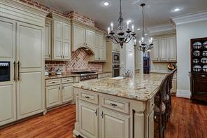 The kitchen has a sophisticated display of cabinetry with hand-painted edging and lots of storage. There's even two large pantries and a butler's pantry adjoining the dining room.