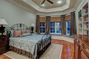 "Also on the first floor, you will experience a luxurious master suite with great natural light, window seats and built-in bookshelves. The space includes a tray ceiling, built-in sound, recessed lights, crown molding, and 12"" baseboards."