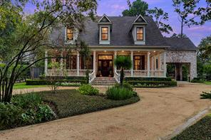 Designed to replicate a southern colonial Charleston home, both the exterior and interior display superb craftsmanship including the raised foundation, dormers, wrap-around porch, Old Bayou brick, transoms, wainscoting, triple crown molding, storm shutters, glass door knobs and southern charm throughout.