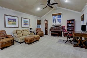 Upstairs in the main house, you will find plenty of living space. This huge game room has a 12' cathedral ceiling. It's ideal for sleep overs, a pool table, or just hanging around.