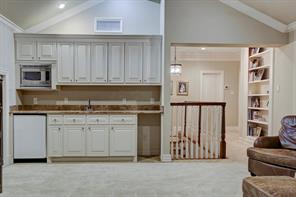 The game room has a built-in wet bar, mini fridge, microwave and room for a beverage cooler.