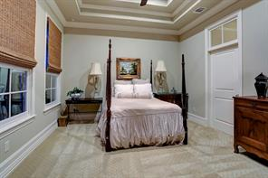 The bedroom suite in the guest house is like another master suite. With high ceilings, divided light windows, transom doorways and plenty of space. This bedroom will please any of those special guests.