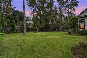 The remainder of the 33,000+SF lot is in the back yard and there is plenty of grassy space for any outdoor activity. The current owners enjoy a vegetable garden, citrus fruit trees, and a compost. The towering tress make you feel like you are out in the country. What a wonderful home.