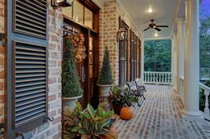 The wrap-around porch is a picture-perfect setting and captures that true southern lifestyle. It comes complete with colonial columns, exposed brick, latchable shutters, gas lanterns, ceiling fans and transom divided light windows.