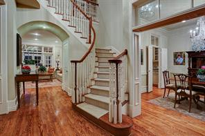 Upon entering, you will be greeted with a traditional two-story foyer, a slight sweeping staircase, gorgeous oak hardwoods, cased openings and grand formals on either side.