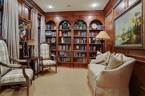 Also upon entering you will be greeted with a stunning formal library with built-in bookshelves, block paneling, and finely crafted stained wood mill work.