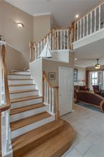 Winding staircase - half bath is door to the right of the stairwell.