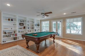 Game room with pool table that converts to ping pong table as well!  French doors lead to upstairs screened in porch!