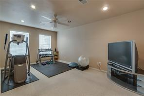 Upstairs secondary bedroom, or fitness room (has closet).