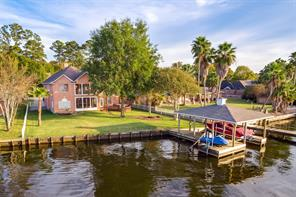 Impressive waterfront with boat dock/life and jet ski lift as well.  Back yard is large enough for pool and outdoor kitchen.