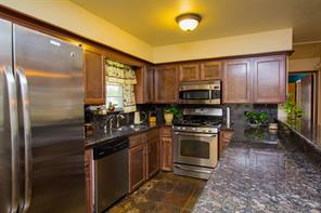 Beautiful kitchen with stainless steal appliances and granite counter tops.