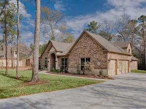 Picture perfect setting and check out the 3 car garage it includes a workshop as well!