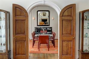 [Dining Room]Tall arched doors announce the entry into the dining room from the living room.