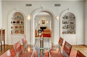 [Dining Room]In the dining room, a pair of Newport-style wall cabinets flank the passage into the living room.