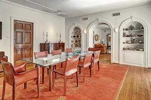 [Dining Room]Paneled pivot door at left accesses the kitchen.