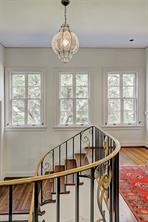 [Staircase Landing]Light-filled staircase landing. Note sinuous lines of the staircase balustrade.