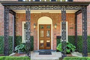 [Entrance]Briscoe's lavish exterior application of wrought-iron accents reflects the Latin Colonial-style of Bayou Bend, a house which he helped design with Staub.