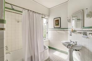 [En Suite Bathroom]Airy bathroom has been modernized but retains its arts and crafts vintage tile accents.