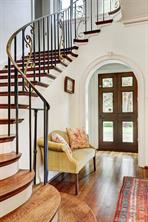 [Foyer]A view into the foyer reveals the exquisite bronze and wrought iron staircase.