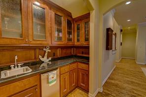 There is a wet bar with an ice maker and butler bar for entertaining. They are located between the dining room and kitchen.