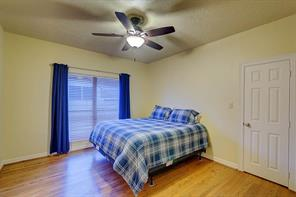 Bedroom #3 has ample space for this large bed. There is a grand walk in closet and a remote control fan.