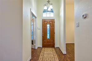 High Ceilings, a chandelier in front of arched window and great wood floors greet you as you enter this like new home. Notice the French doors on the left which enter into the study. Enter to the right to the formal dining room.