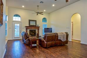 This  extra large family room has a gaslog fireplace with stone surround and beautiful wood mantel.  The back door even has plantation shutters.
