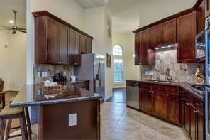 Home has a great full back splash on each kitchen wall that ties in with the neutral colors of the home. Straight ahead past the kitchen is the formal dining. To the right of the dining room is the hall way to the master suite, garage and laundry room.