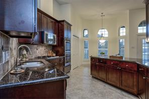 Really move in ready home! Home looks like no one has ever lived here. Immaculate home, well taken care of! Brushed nickel hardware, stainless double sinks, beautiful wood cabinets, tile floors and crushed marble backsplash complete this kitchen.