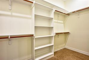 Lots of room as well as a little extra shelving is in this master closet which is off the master bathroom.