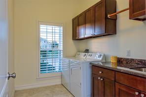 Great storage in this laundry room. Granite and a stainless sink even in this room!
