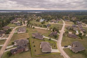 Location! Location! Location! See Lake Conroe in the background and the Pond in The Meadows a block or so from the house. Bentwood Dr. is just a half block away. Second gated entry is about 3 blocks to the right on Bentwood Dr.