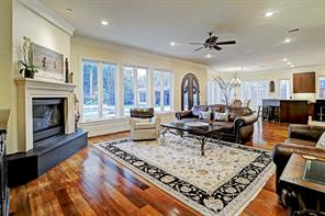 The large FAMILY ROOM with a corner gas-log fireplace with cast stone mantel and a wide hearth.   Notice the lovely openness of the Family Room, Breakfast Room and Gourmet Kitchen.