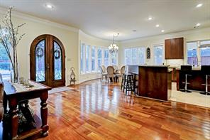 The second set of double MAHOGANY & GLASS DOORS lead out to the sumptuous BACKYARD OASIS.  Don't you love the arches, curved walls and double crown molding - and how about all of those windows?