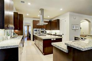 A closer view of the GOURMET KITCHEN.  Notice the granite counter tops, gleaming cabinetry and plentiful recessed lighting.
