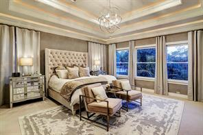 What an exquisite MASTER BEDROOM with a double tray ceiling with exceptional crown moldings, large windows facing the backyard and side yard, plush neutral carpeting, two master bathrooms (with one shared walk-in shower), and a connected sitting room.