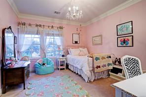 Precious SECONDARY BEDROOM with large windows for natural light and a sparkling chandelier.