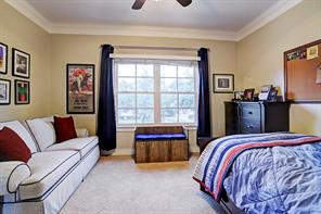 Another SECONDARY BEDROOM with large windows, plush neutral carpeting and connected bathroom.