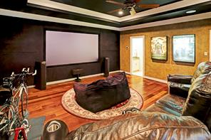 MEDIA ROOM with double tray ceiling, ample room for widescreen TV & sound system, access to Hollywood Bath and gleaming hardwood floors.