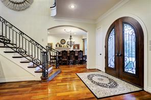 Back to the FOYER that showcases the FORMAL DINING ROOM through the arched entry.  Coat and storage closets are on either side of the double front doors.